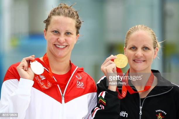 Silver medalist Margaret Hoelzer of the United States and gold medalist Kirsty Coventry of Zimbabwe pose during the medal ceremony for the Women's...