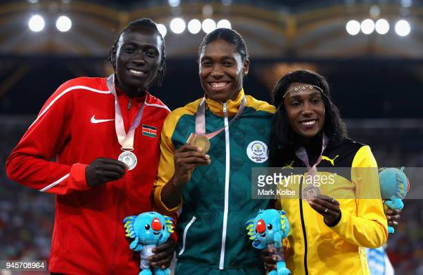 Silver medalist Margaret Nyairera Wambui of Kenya gold medalist Caster Semenya of South Africa and bronze medalist Natoya Goule of Jamaica pose...