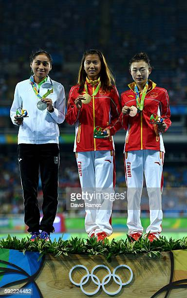Silver medalist, Maria Guadalupe Gonzalez of Mexico, gold medalist, Hong Liu of China, and bronze medalist Xiuzhi Lu of China, pose on the podium...
