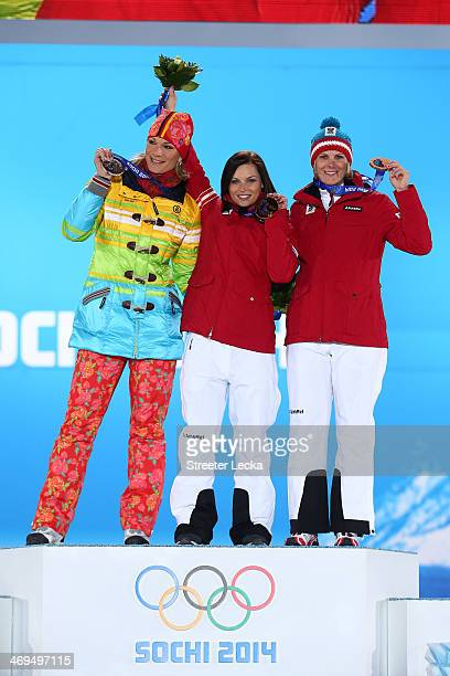 Silver medalist Maria Hoefl-Riesch of Germany, gold medalist Anna Fenninger of Austria and bronze medalist Nicole Hosp of Austria on the podium...