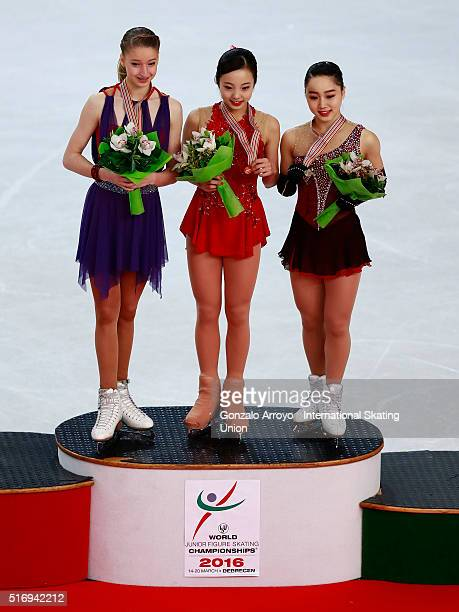 Silver medalist Maria Sotskova from Russia gold medalist Marin Honda from Japan and bronce medalist Wakaba Higuchi from Japan pose for a pciture at...
