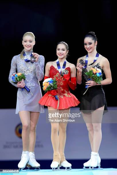 Silver medalist Maria Sotskova of Russia gold medalist Alina Zagitova of Russia and bronze medalist Kaetlyn Osmond of Canada pose on the podium at...