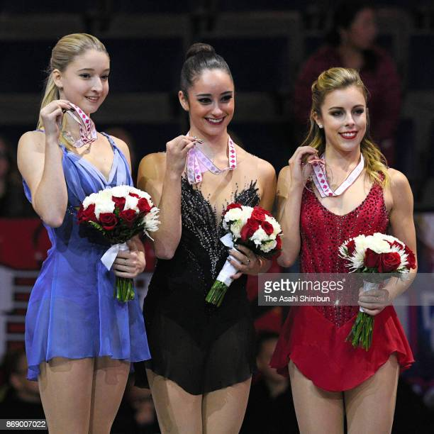 Silver medalist Maria Sotskova of Russia gold medalist Kaetlyn Osmond of Canada and bronze medalist Ashely Wagner of United States pose on the podium...