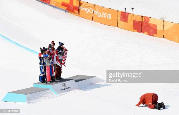Silver medalist Marie Martinod of France gold medalist Cassie Sharpe of Canada and bronze medalist Brita Sigourney of the United States celebrate on...