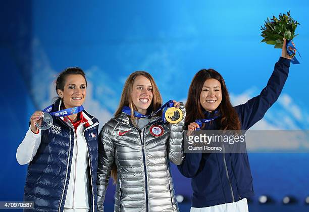 Silver medalist Marie Martinod of France gold medalist Maddie Bowman of the United States and bronze medalist Ayana Onozuka of Japan celebrate during...