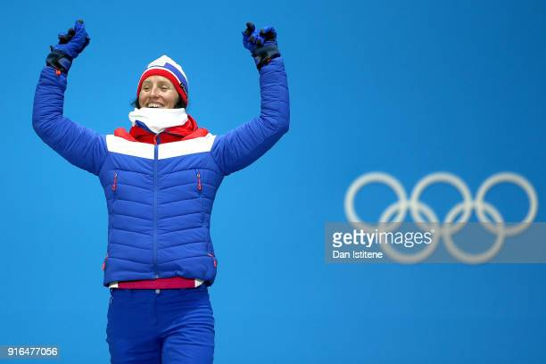 Silver medalist Marit Bjoergen of Norway celebrates on the medal stand during the Medal Ceremony for the CrossCountry Skiing Ladies' 75km 75km...