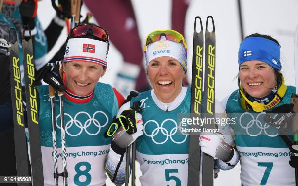 Silver medalist Marit Bjoergen of Norway gold medalist Charlotte Kalla of Sweden and bronze medalist Krista Parmakoski of Finland pose after the...