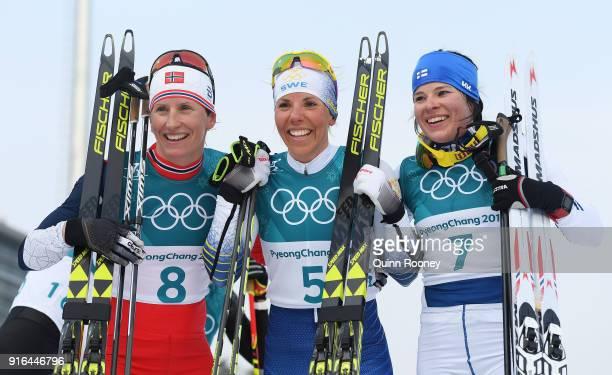 Silver medalist Marit Bjoergen of Norway gold medalist Charlotte Kalla of Sweden and bronze medalist Krista Parmakoski of Finland pose after the...