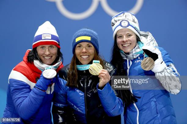 Silver medalist Marit Bjoergen of Norway gold medalist Charlotte Kalla of Sweden and bronze medalist Krista Parmakoski of Finland pose during the...
