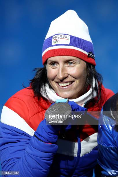 Silver medalist Marit Bjoergen of Norway poses during the Medal Ceremony for the Cross-Country Skiing Ladies' 7.5km + 7.5km Skiathlon on day one of...