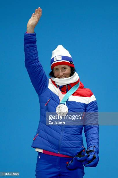 Silver medalist Marit Bjoergen of Norway poses during the Medal Ceremony for the CrossCountry Skiing Ladies' 75km 75km Skiathlon on day one of the...