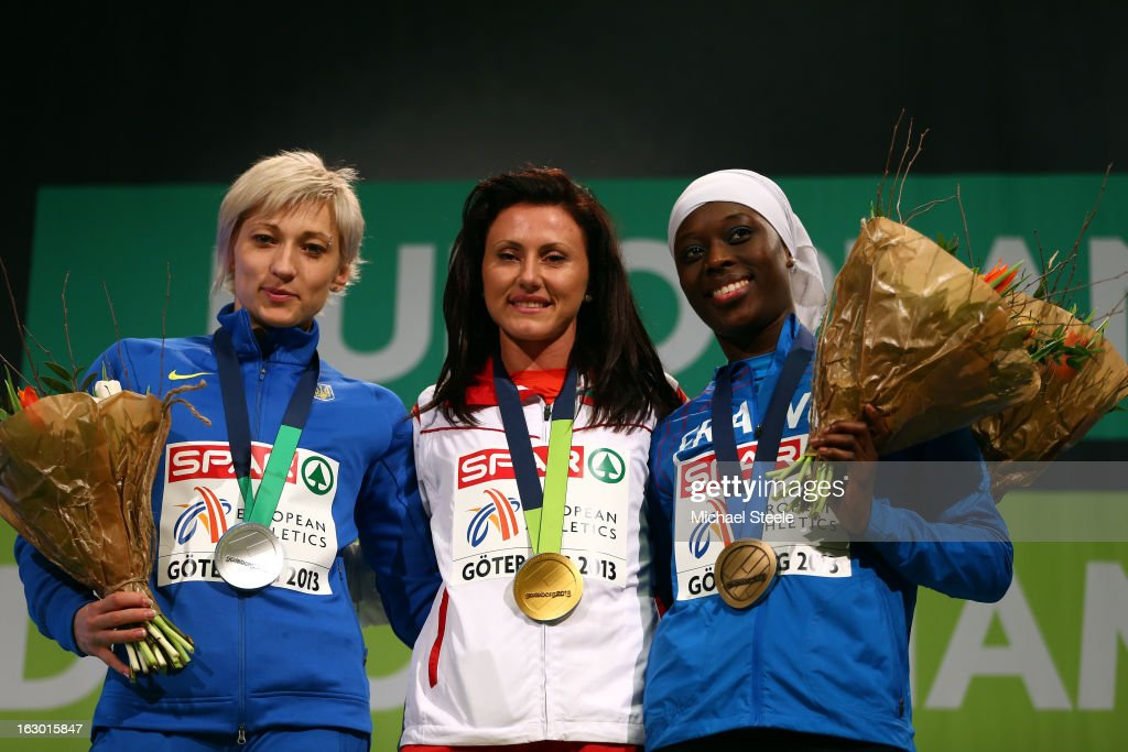 Silver medalist Mariya Ryemyen of Ukraine, gold medalist Tezdzhan Naimova of Bulgaria and bronze medalist Myriam Soumare of France pose during the victory ceremony for the Women's 60m during day three of European Indoor Athletics at Scandinavium on March 3, 2013 in Gothenburg, Sweden.