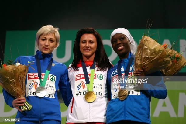 Silver medalist Mariya Ryemyen of Ukraine gold medalist Tezdzhan Naimova of Bulgaria and bronze medalist Myriam Soumare of France pose during the...