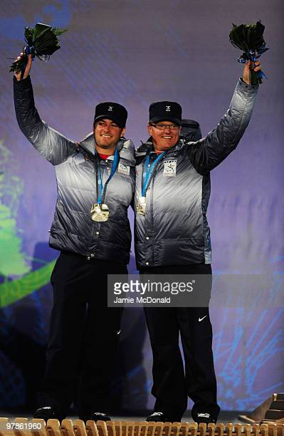 Silver medalist Mark Bathum of USA and guide Storey Slater celebrate during the medal ceremony for the Men's Visually Impaired Downhill on Day 7 of...