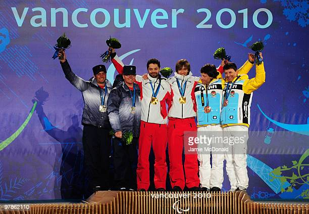 Silver medalist Mark Bathum of USA and guide Storey Slater , gold medalist Jon Santacana Maiztegui of Spain and guide Miguel Galindo Garces and...