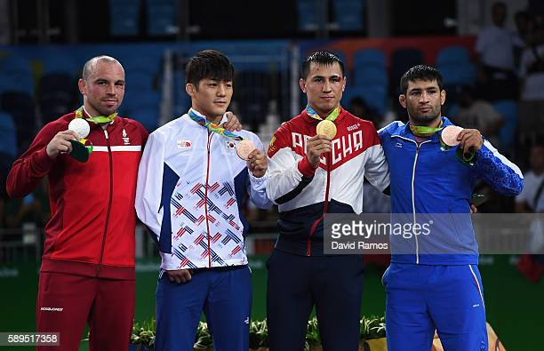 Silver medalist Mark Overgaard Madsen of Denmark bronze medalist Hyeonwoo Kim of Korea gold medalist Roman Vlasov of Russia and bronze medalist Saeid...