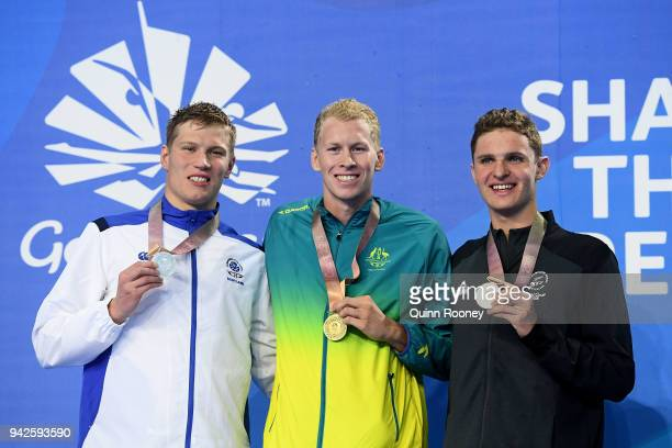 Silver medalist Mark Szaranek of Scotland gold medalist Clyde Lewis of Australia and bronze medalist Lewis Clareburt of New Zealand pose during the...