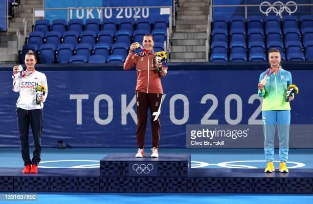 Silver medalist Marketa Vondrousova of Team Czech Republic, gold medalist Belinda Bencic of Team Switzerland and bronze medalist Elina Svitolina of...