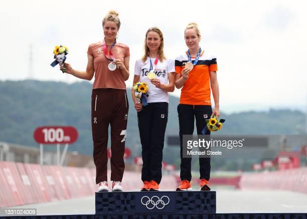Silver medalist Marlen Reusser of Team Switzerland, gold medalist Annemiek van Vleuten of Team Netherlands, and bronze medalist Anna van der Breggen...