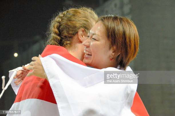 Silver medalist Marlene van Gansewinkel of the Netherlands and gold medalist Maya Nakanishi of Japan embrace after competing in the Women's Long Jump...