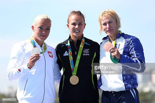 R] Silver medalist Marta Walczykiewicz of Poland gold medalist Lisa Carrington of New Zealand and bronze medalist Inna OsipenkoRodomska of Azerbaijan...