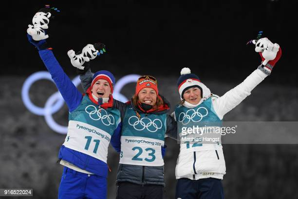 Silver medalist Marte Olsbu of Norway gold medalist Laura Dahlmeier of Germany and Veronika Vitkova of the Czech Republic pose during the victory...