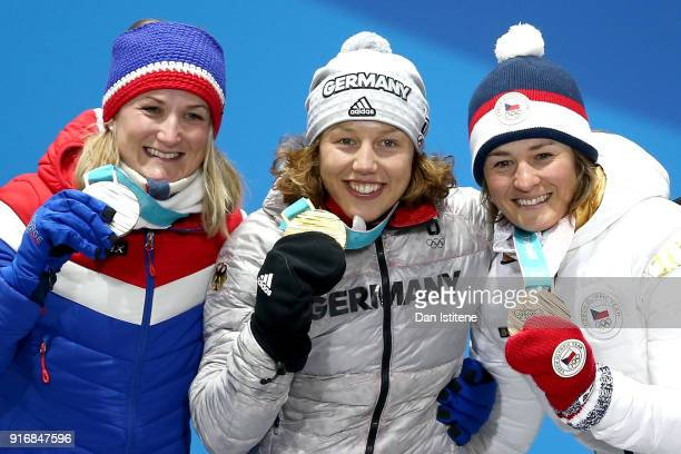 Silver medalist Marte Olsbu of Norway gold medalist Laura Dahlmeier of Germany and bronze medalist Veronika Vitkova of the Czech Republic pose on the...