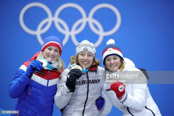 Silver medalist Marte Olsbu of Norway gold medalist Laura Dahlmeier of Germany and bronze medalist Veronika Vitkova of the Czech Republic pose during...
