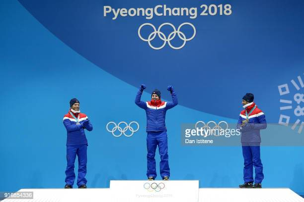 Silver medalist Martin Johnsrud Sundby of Norway gold medalist Simen Hegstad Krueger of Norway and bronze medalist Hans Christer Holund of Norway...