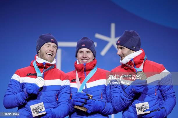 Silver medalist Martin Johnsrud Sundby of Norway, gold medalist Simen Hegstad Krueger of Norway and bronze medalist Hans Christer Holund of Norway...