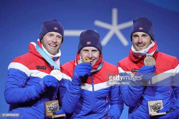 Silver medalist Martin Johnsrud Sundby of Norway gold medalist Simen Hegstad Krueger of Norway and bronze medalist Hans Christer Holund of Norway...