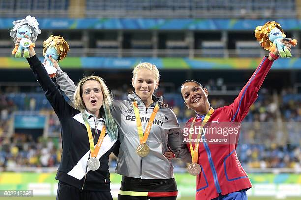 Silver medalist Martina Caironi of Italy Gold medalist Vanessa Low of Germany and Bronze medalist Malu Perez Iser of Cuba celebrate on the podium at...