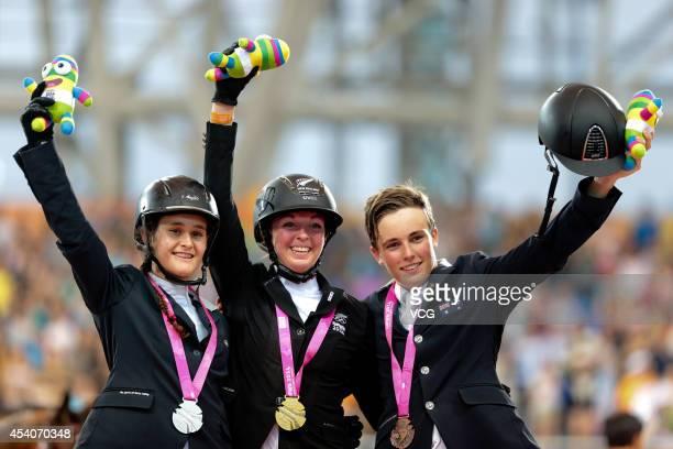 Silver medalist Martina Campi of Argentina Gold medalist Emily Fraser of New Zealand and Bronze medalist Jake Hunter of Australia celebrate on the...