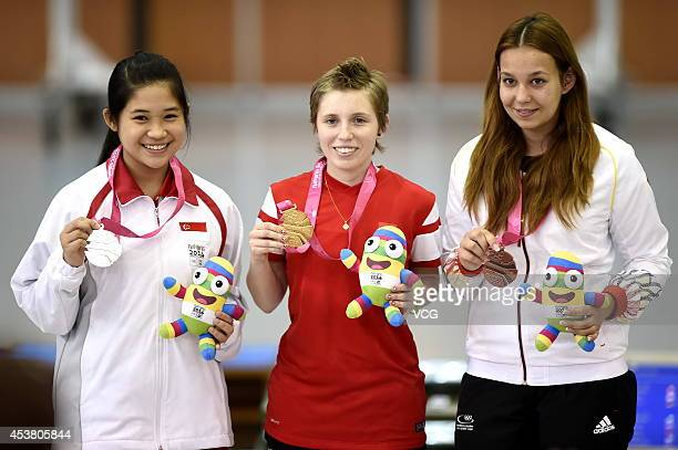 Silver medalist Martina Lindsay Veloso of Singapore Gold medalist Sarah Hornung of Switzerland and Bronze medalist Julia Budde of Germany celebrate...
