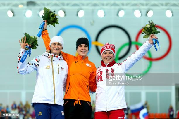 Silver medalist Martina Sablikova of the Czech Republic gold medalist Irene Wust of the Netherlands and bronze medalist Olga Graf of Russia celebrate...
