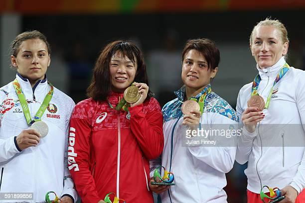 Silver medalist Maryia Mamashuk of Belarus, gold medalist Risako Kawai of Japan, bronze medalist Yekaterina Larionova of Kazakhstan and bronze...