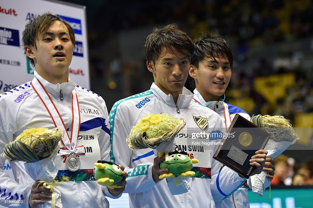 Silver medalist Masaki Kaneko, gold medalist Ryosuke Irie and bronze medalist Keita Sunama pose for photographs on the podium after the Men's 200m Backstroke final during the Japan Swim 2016 at Tokyo Tatsumi International Swimming Pool on April 9, 2016 in Tokyo, Japan.