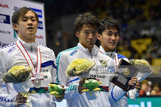 Silver medalist Masaki Kaneko gold medalist Ryosuke Irie and bronze medalist Keita Sunama pose for photographs on the podium after the Men's 200m...