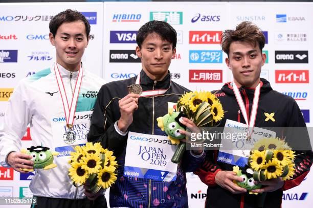 Silver medalist Masaki Kaneko of Japan, gold medalist Ryosuke Irie of Japan and bronze medalist Taishi Natsume of Japan pose during the medal...