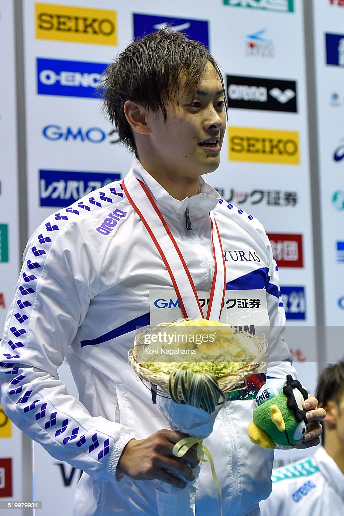 Silver medalist Masaki Kaneko poses for photographs on the podium after the Men's 200m Backstroke final during the Japan Swim 2016 at Tokyo Tatsumi International Swimming Pool on April 9, 2016 in Tokyo, Japan.