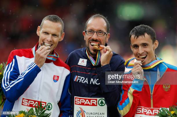 Silver medalist Matej Toth of Slovakia gold medalist Yohann Diniz of France and bronze medalist Ivan Noskov of Russia stand on the podium during the...