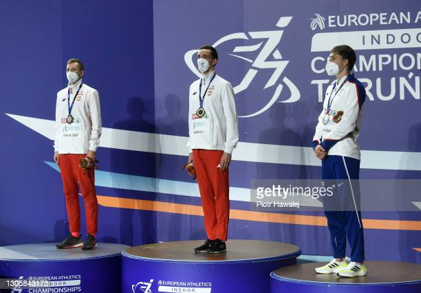 Silver medalist Mateusz Borkowski of Poland, gold medalist Patryk Dobek of Poland and bronze medalist Jamie Webb of Great Britain look on during the...