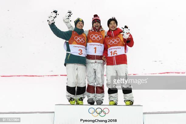 Silver medalist Matt Graham of Australia gold medalist Mikael Kingsbury of Canada and bronze medalist Daichi Hara of Japan pose during the victory...