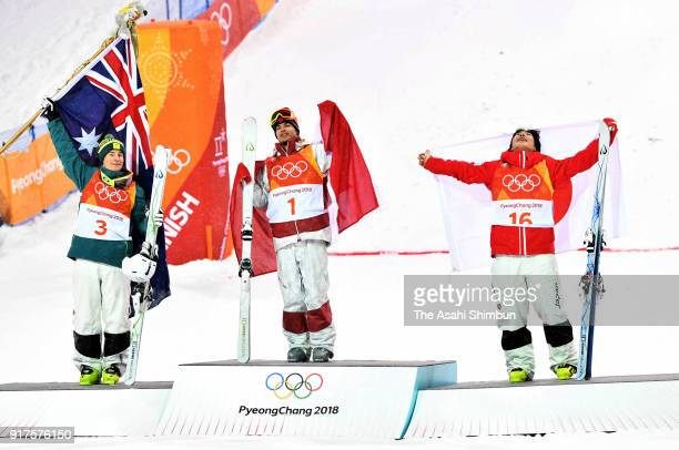 Silver medalist Matt Graham of Australia gold medalist Mikael Kingsbury of Canada and bronze medalist Daichi Hara of Japan celebrate on the podium...