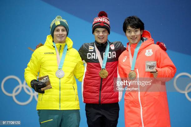 Silver medalist Matt Graham of Australia gold medalist Mikael Kingsbury of Canada and bronze medalist Daichi Hara of Japan pose during the medal...