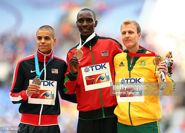 Silver medalist Matthew Centrowitz of the United States, gold medalist Asbel Kiprop of Kenya and bronze medalist Johan Cronje of South Africa stand...