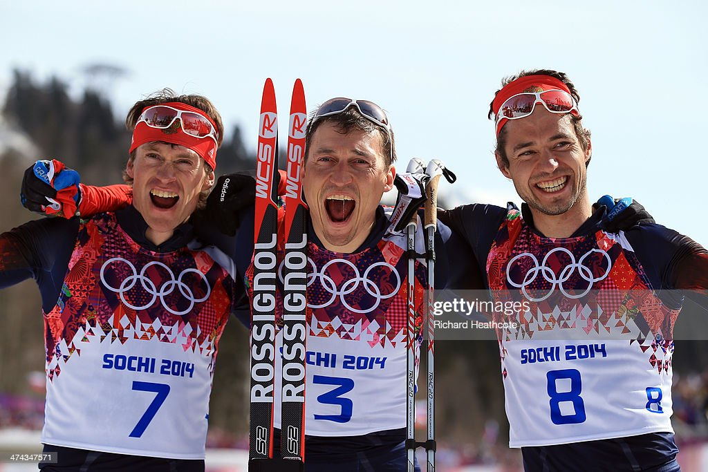 Silver medalist Maxim Vylegzhanin of Russia, gold medalist Alexander Legkov of Russia and bronze medalist Ilia Chernousov of Russia celebrate after the Men's 50 km Mass Start Free during day 16 of the Sochi 2014 Winter Olympics at Laura Cross-country Ski & Biathlon Center on February 23, 2014 in Sochi, Russia.
