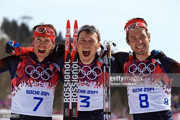 Silver medalist Maxim Vylegzhanin of Russia, gold medalist Alexander Legkov of Russia and bronze medalist Ilia Chernousov of Russia celebrate after...