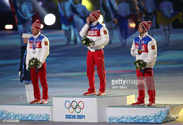 Silver medalist Maxim Vylegzhanin of Russia gold medalist Alexander Legkov of Russia and bronze medalist Ilia Chernousov of Russia celebrate during...