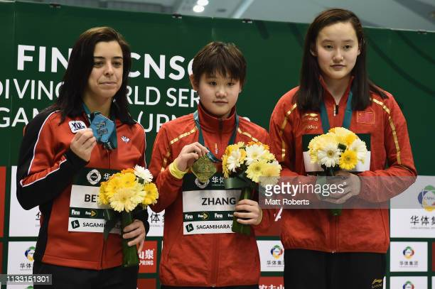 Silver medalist Meaghan Benfeito of Canada gold medalist Jiaqi Zhang of China and bronze medalist Qian Ren of China pose during the medal...